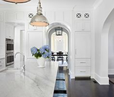 Traci Rhoads Interiors everything is amazing.  love the millwork over the doorway instead of cabinets.  counter!  floor colour and bar stools - want and love!
