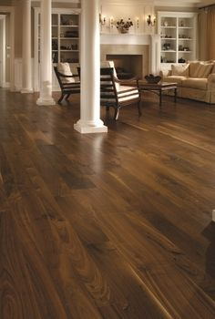 gorgeous walnut flooring... perfect for a cream wall
