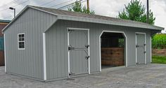 2 stall shed row barn with center run-in or hay/equipment storage area