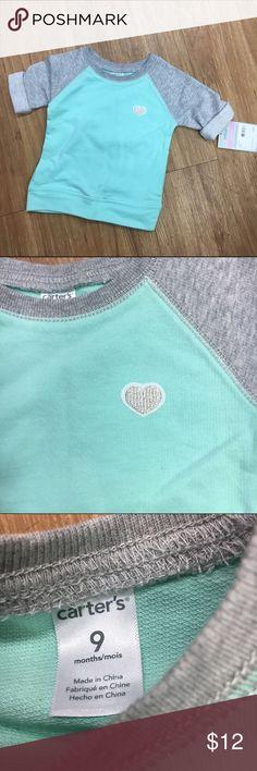 Carter's Aqua Gray Sweatshirt NEW NWT 9 mo Heart Such a cute and fun sweatshirt from Carter's.  Size is 9 mo.  Sleeves are raglan.  Side slit pockets on each side.  #new #nwt #raglan #sweatshirt #aqua #gray #showergift #babyshower Carter's Shirts & Tops Sweatshirts & Hoodies