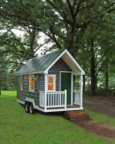 Available in several easily transportable sizes, the Tiny Green Cabin is a customizable steel- or wood-framed small home that includes myriad eco-friendly details: low-VOC paints, locally harvested lumber, and recycled denim insulation. Solar panels and c Tiny House Cabin, Tiny House Living, Tiny House Plans, Tiny House On Wheels, Little Houses, Tiny Houses, Tiny House Movement, Tiny Spaces, Kit Homes
