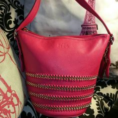 COACH Pink Crossbody Bucket 100% authentic pink cross body bag with gold chain trim. This bag was purchased at Macy's summer 2015 and is 100% authentic. Made of soft buttery leather. Horse & buggy carriage engraved on front I've carried it ONCE. Excellent condition.  Long adjustable strap approx. 53in. Bag size is approximately 10 1/2 across the top, 9in high and 6 1/2 across the bottom. These are approximate as I don't have a tape measure. It is standard small bucket coach bag. Coach Bags…