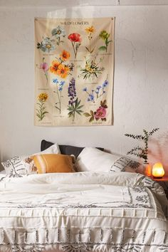 Botanical Wildflower Reference Chart Tapestry at Urban Outfitters. This is so beautiful and such a simple way to add floral color and a pop of something fresh to your decor! Teen Room Decor, Bedroom Decor, Yellow Room Decor, Dorm Room Art, Bed Room, Ideas Habitaciones, Aesthetic Bedroom, My New Room, Dorm Decorations