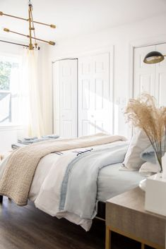 Light airy neutral bedroom design with blue bedding and rattan mirror on Thou Sw. Light airy neutral bedroom design with blue bedding and rattan mirror on Thou Swell by Kevin O'Gara Tan Bedroom, Airy Bedroom, Blue Bedroom Decor, Guest Room Decor, Bedroom Ideas, Master Bedroom, Bedroom Colours, Bedroom Inspiration, Pale Blue Bedrooms