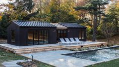 New York design studio General Assembly has added a pool house to a property on Shelter Island, cladding the exterior of the small structure with blackened timber siding.