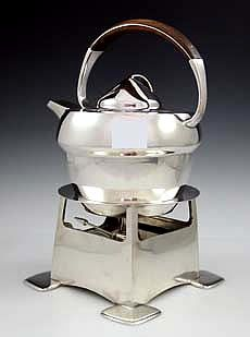 Archibald Knox (1864-1933) - For Liberty & Co. - Kettle on Stand. Sterling Silver with Wooid Handle. Birmingham, England. Circa 1902.