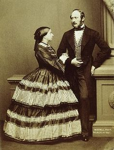 Queen Victoria and Prince Albert, 1861. He wears a frock coat, vest and trousers. Photo by Mayall, courtesy of V and A museum.