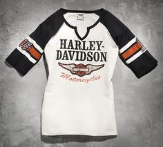 Live the legend in the Harley-Davidson® Women's Iconic Henley Tee. A flattering v-neck silhouette makes this tee an eye-catching addition to your wardrobe.