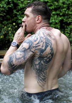 Tom Hardy shirtless muscles tattoos Mmmm....this is way sexy... And hot... And delicious... What a beast. I can't handle it. Damn....