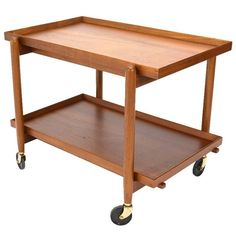Danish Teak Serving Cart by Poul Hundevad | From a unique collection of antique and modern bar carts at https://www.1stdibs.com/furniture/tables/bar-carts/
