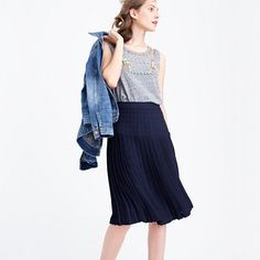 "An airy A-line skirt that's superflattering, thanks to pleats that lay flat at the waist and hips, with a midi length that's perfect for all your work and<i> </i>weekend activities. <ul><li>Sits above waist.</li><li>24"" long.</li><li>Falls above knee.</li><li>Poly.</li><li>Back zip.</li><li>Lined.</li><li>Dry clean.</li><li>Import.</li><li></li></ul>"