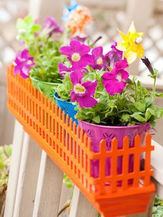 LOVE the bright colors..would be cute to fence in a little part of the yard.