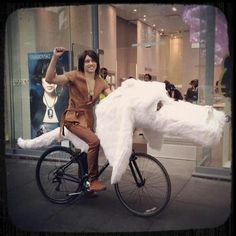 Atreyu and Falkor the Luckdragon from The Neverending Story - I think this manages to totally beat both my Chinese New Year dragon bike costume and my E.T. & Elliott one... -MP