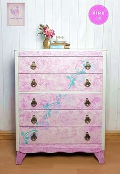 Very feminine painted chest of drawers with 5 drawers. Brass handles, little legs and a curved bottom rail. The paint was Autentico Silver, Heliotrope, Poetic, and some Annie Sloan green, chalk paint applied in a mottled effect with a sponge and then a rose stencil on the front and top. Its waxed to finish, and stencilled on the drawer sides too. A beautiful vintage piece with bags of charm and would be fabulous in a girls' bedroom. Made by Lebus, and drawers lined in Laura Ashley paper.
