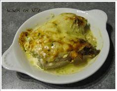 ....een heerlijke ovenschotel met witloof met boursin, schijfjes kip en geraspte kaas.                Benodigdheden:  4 stronkjes witloof  ...