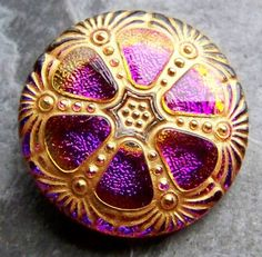 Vintage Czech glass button purple and gold floral from https://www.etsy.com/listing/226931736/vintage-button-glass-button-czech-button?ref=favs_view_4