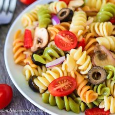 Pasta salad is a very quick and easy way to add a colorful side to your lunch or dinner. Its so filling it could be considered a meal by itself.      Ingredients:  1 (12 oz) package tri-color rotini  2/3 cup red bell pepper, chopped  1/2 cup red onion, chopped  1 cup cherry