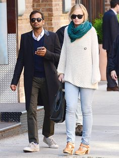 Aziz Ansari and Courtney McBroom. Love the sweater and scarf!