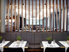 furnishings restaurant and breakfast area, nutwooden wall coverings, slatwalls, lamella partition walls