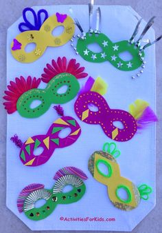 How to decorate a mardi gras mask.  Kids craft with 14 items from the Dollar Tree used to decorate a Mardi Gras mask from Activities for Kids