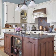 Nice contrast between cabinets and island.