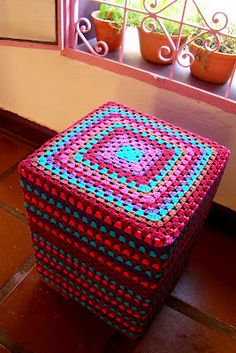 Wouldn't this make a great Doggie Seat in front of a window? Instructions are in Spanish but basically just cover a tall stool with a Granny Square. Right? Link to the basic Granny Square directions included.