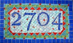 """""""2704"""" - MOSAIC HOUSE NUMBERS; vitreous glass on backerboard on plywood; 13 1/2"""" wide x 8 1/2"""" high"""