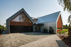 RS unites two materialistically opposing barns into a cohesive home - designboom | architecture