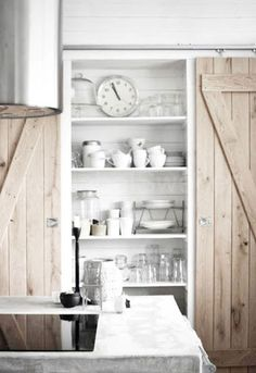 best of both worlds: open kitchen shelves and a barn door to close it off . Also concrete counter, natural wood - the style files Barn Door Pantry, Barn Doors, Wooden Pantry, Indoor Sliding Doors, Home Design, Interior Design, Design Ideas, Design Diy, Open Kitchen