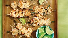 Coconut Lime Shrimp Skewers | Mix up some pineapple drops and dig into our finger-food version (no whole pig necessary)