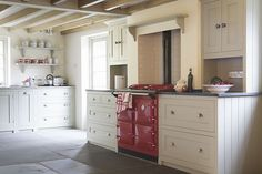 classic English kitchen with red aga  This would be great in that Italian villa we want ;)