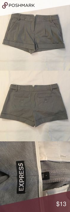 Express Gray Shorts Go for the classic look! These gray shorts are semi- pleated in the front along with a zip and button closure. Feature two front pockets and are made of polyester. They've never been worn! Express Shorts
