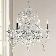 Chrome finish crystal chandelier with crystal pendants and beads.
