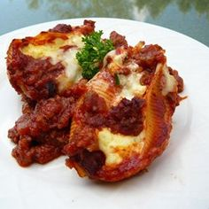 Lasagna Stuffed Shells - reviewers' suggestions - ricotta vs. cottage cheese, spaghetti sauce vs. tomato paste, Italian sausage vs. ground beef, plastic baggie with corner cut out can pipe cheese mixture into shells