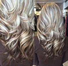 Light blonde highlights, medium/dark brown lowlights plus layers!