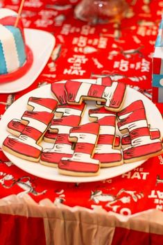 seuss birthday party ideas<br> The BEST Dr. Seuss Birthday Party Ideas including a Red Fish, Blue Fish Candy Bar, Dr. Seuss inspired cake, Cat in the Hat cookies and more! Boys First Birthday Party Ideas, Dr Seuss Birthday Party, Baby Boy Birthday, Boy Birthday Parties, 2nd Birthday, 1st Birthday Themes, Dr. Seuss, Dr Seuss Party Ideas, Ideas Party