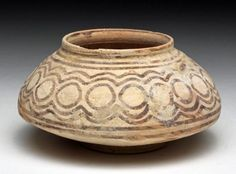 Indus Valley pottery jar, Pakistan, 3rd millenium B.C. Beautiful thinly potted jar, with small foot, decorated with gray geometric patterns, 9 cm diameter. Private collection