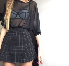 Black mesh shirt with a color blocking bra inside, and black midi skirt. Great urban summer outfit