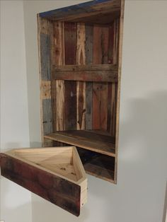 Add shelves and a drawer to your wall alcove using pallet boards