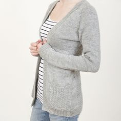 This simple open front cardigan is knit in one piece from the top down with raglan shaping for the sleeves. Apart from the pockets it is completely seamless. It features flattering a-line shaping and a twist stitch pattern on the back and pockets.