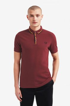 Fred Perry Tipped Placket Polo Shirt- Port (Fred Perry). Our classic polo shirt- made in cotton piqué in our regular fit. Trimmed with twin tipping at the placket with concealed buttons. Punk Store, Fred Perry, Arrow Keys, Close Image, Punk Rock, Good Music, Polo Shirt, Polo Ralph Lauren, Guys