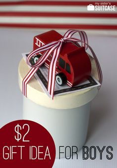 roll of masking tape and new car - use for masking tape roads on the carpet on cold wintery days! With Printable Tag! #gift #boy #printable www.sisterssuitcaseblog.com