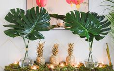 We can't get over how cute this party theme is. Southern Hospitality meets NYC Possibility came alive in spray painted pineapples, pink paper lanterns and Justin's incredible taste. See the details in the slideshow. Havanna Party, Tropical Party Decorations, Tropical Decor, Tropical Interior, Pineapple Party Decor, House Warming Party Decorations, Luau Table Decorations, Tropical Centerpieces, Tropical Bridal Showers