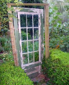 Vintage door as a garden gate.  Love this!