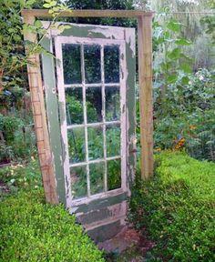 Vintage door as a garden gate.  Love this!