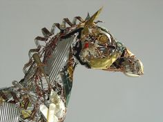 detail of 'A Sure Thing' - Barbara Franc - Recycled metals, steel &copper wire, decorative tins, watch parts, keys, cutlery.