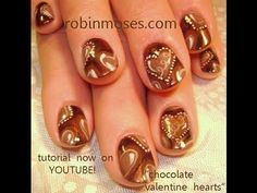 a box of dark chocolate candy valentine heart design: robin moses nail art tutorial