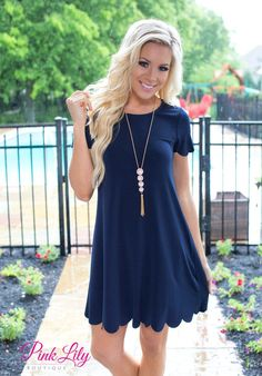 This dress will make you wish springtime was forever! The navy color paired with the scalloped details on the sleeves and bottom hemline is so soft and feminine, while the lightweight material is great for warm spring and summer days.