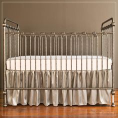The joy baby crib in pewter is so simple and elegant. The perfect crib for your  #vintage #neutral #nursery.  Shop:brattdecor.com