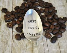 """""""Must have coffee"""" embedded in a spoon"""